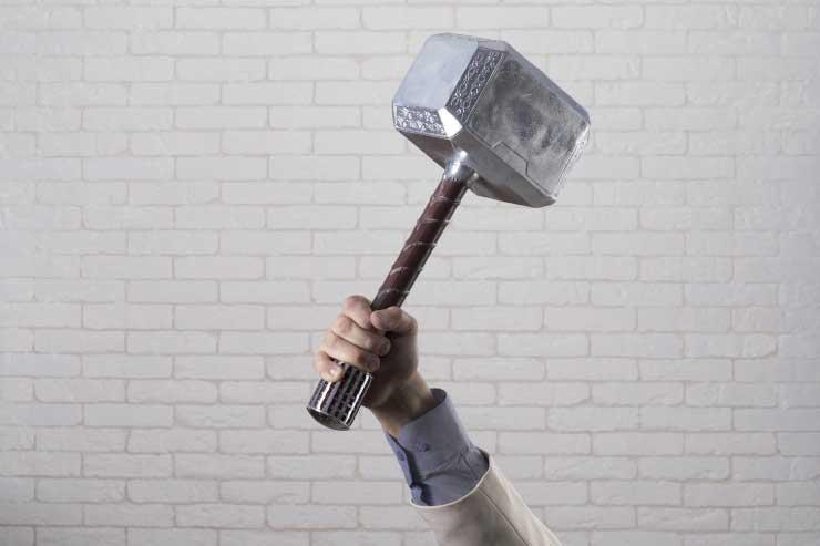 hand holds Thor's hammer