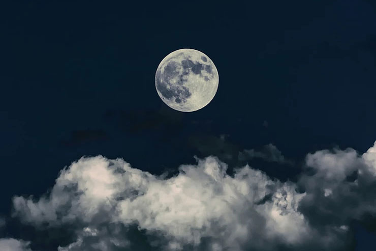 Full moon on top of clouds
