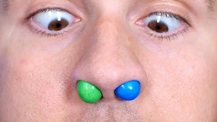 Person with candy up their nose