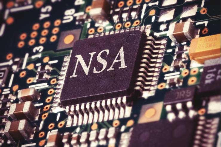 """Zoomed in view of a computer chip with """"NSA"""" printed on it."""