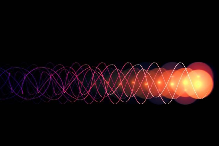 an illustration of a photon on a black backdrop