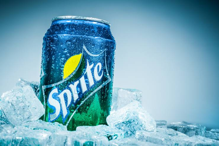 a can of sprite surrounded by ice cubes