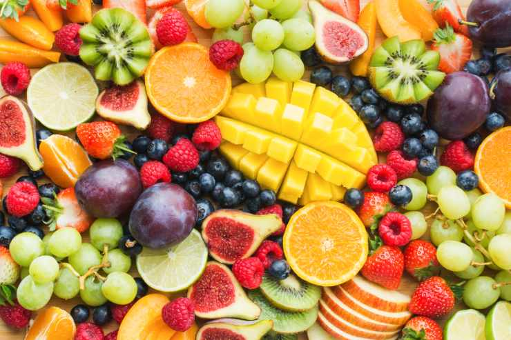 a close up of various cut fruits on a plate