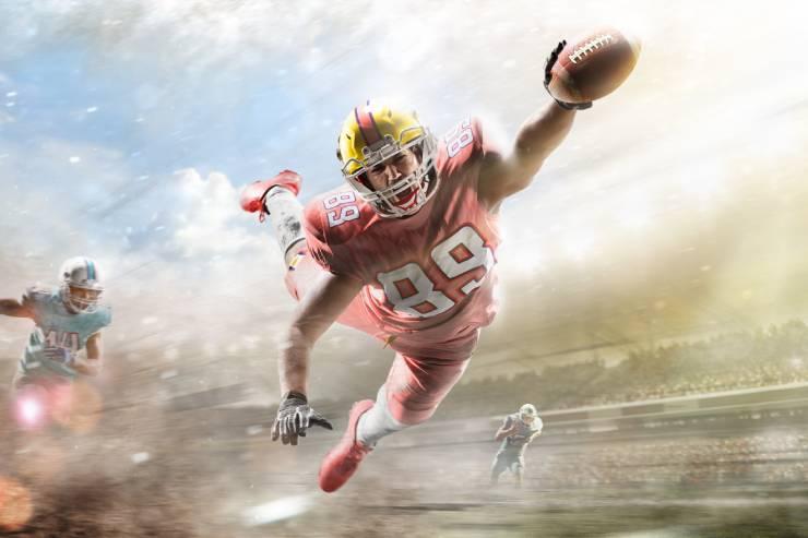 a quarterback dives for the endzone