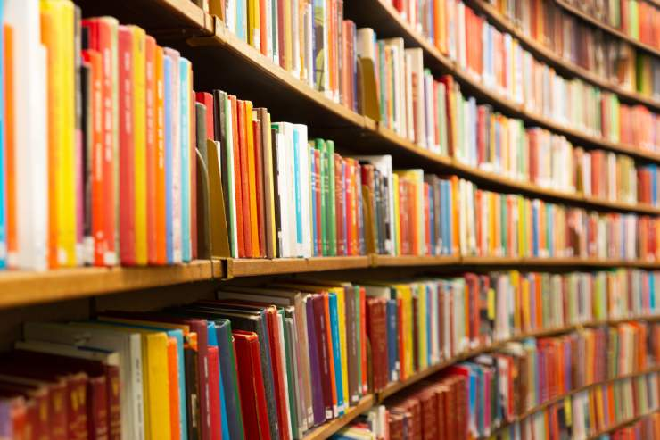 library shelves filled with colorful books