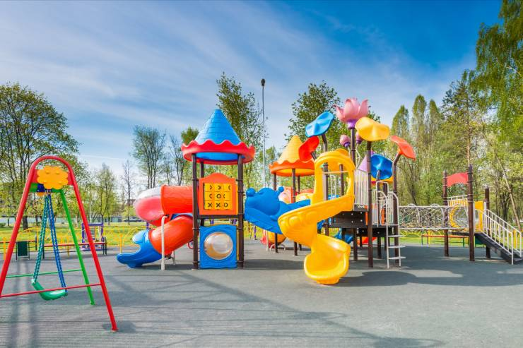 a colorful playground with swings and slides