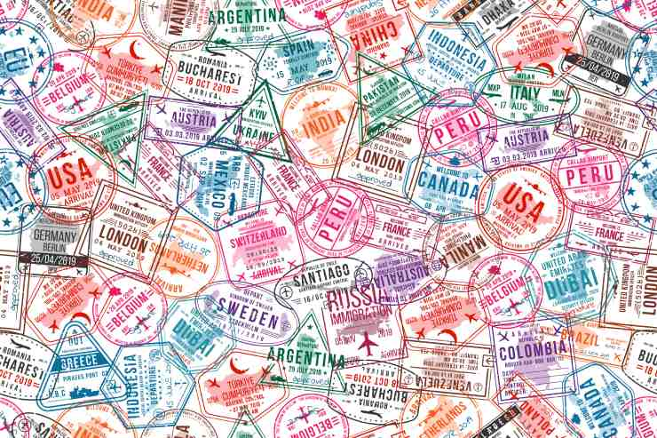 Assortment of Colorful Travel Stamps from Various Locations Around the World.