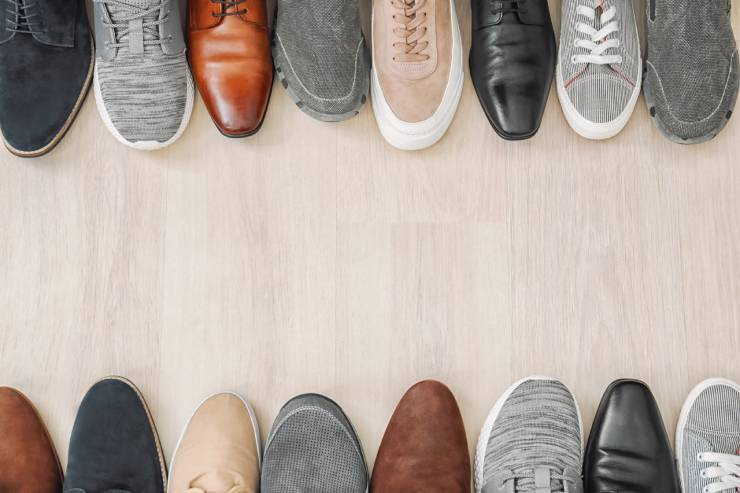 Various Shoes Lined up in Two Rows at the Top and Bottom of the Image.
