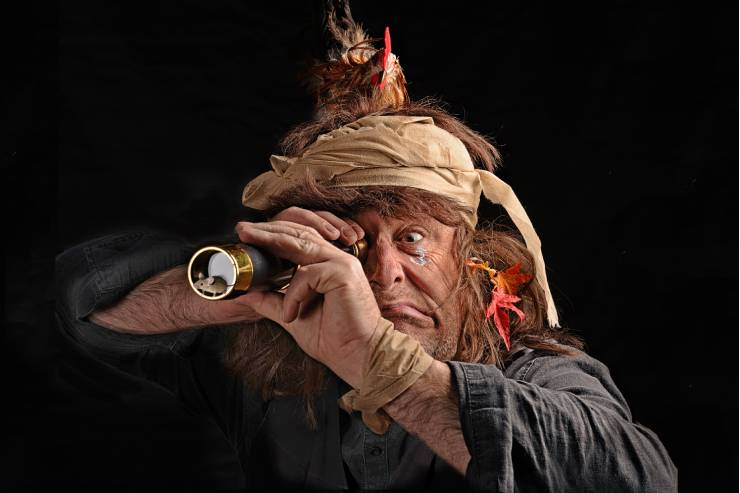 A Pirate Looking Through a Spyglass with a Snarly Expression on his Face and a Bird on his Head.