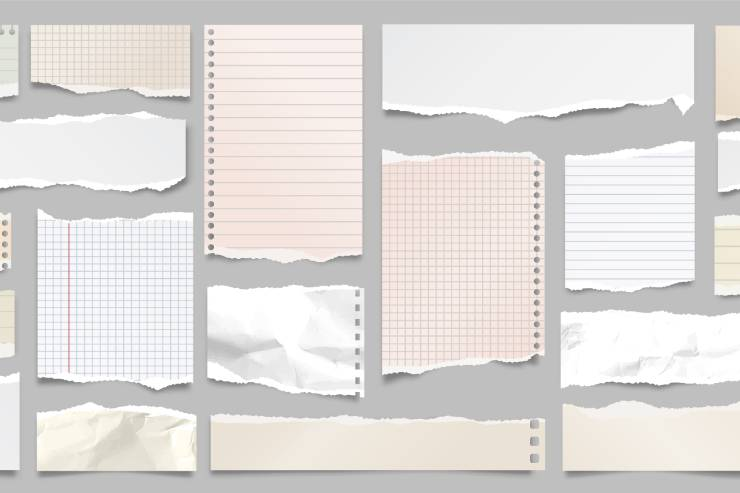 Various scraps of paper, of various size and shade, laid out in a mosaic pattern.