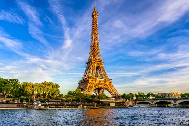 a scenic shot of the Eiffel Tower with the Seine River in front