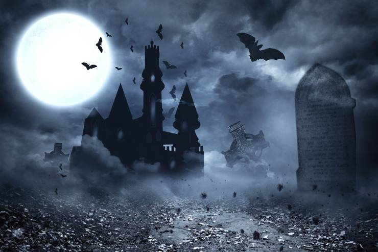 a spooky, full-moon night scene of a castle and a foggy graveyard with bats flying around