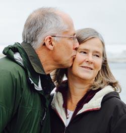 A man kisses a woman's cheek