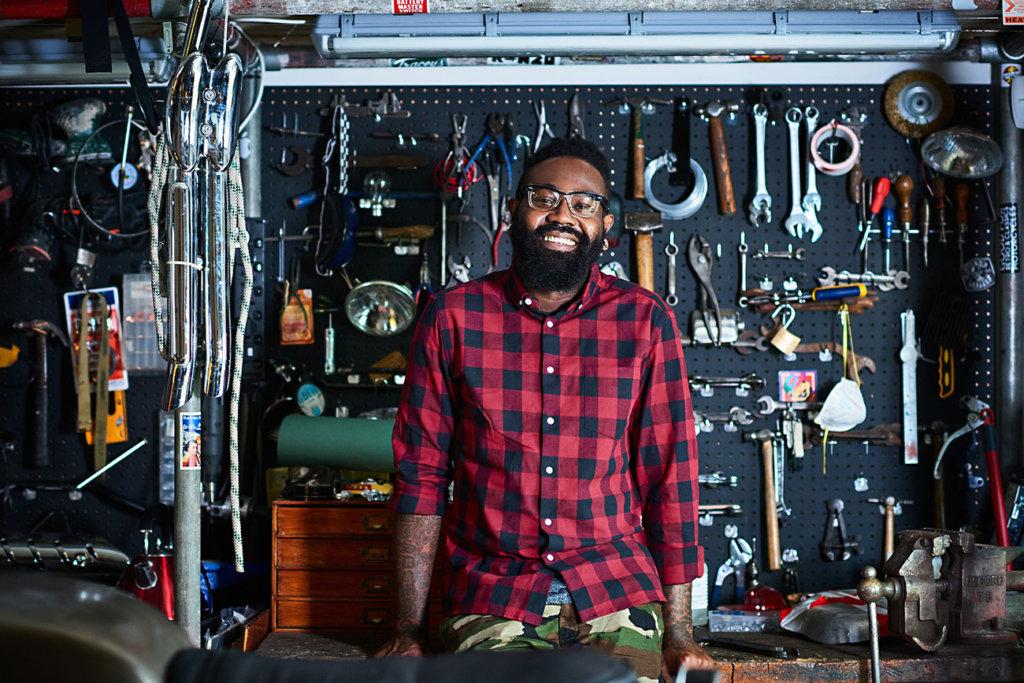 Owner in motorcycle workshop.