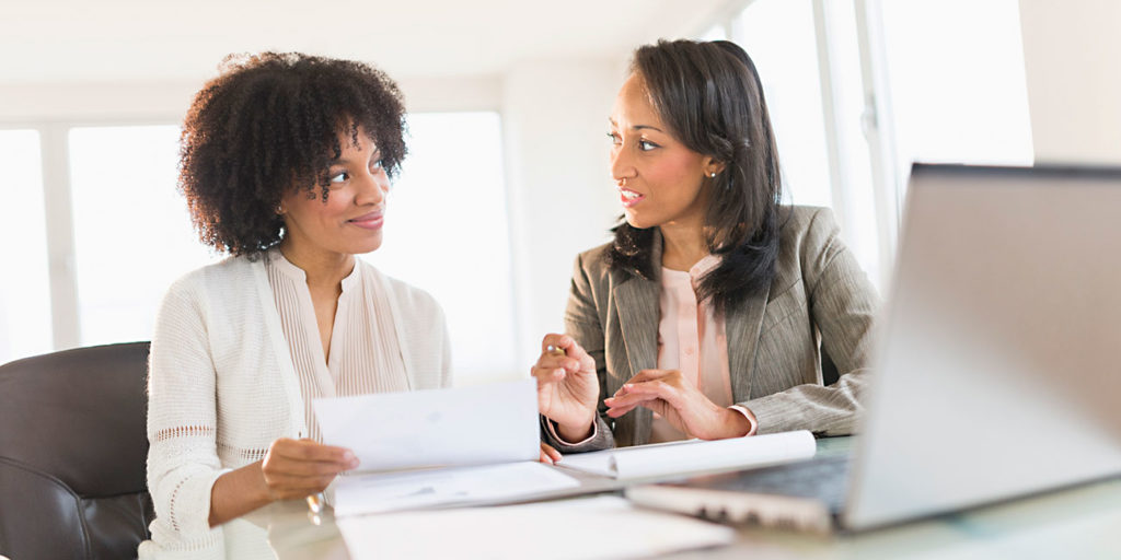 African American tax preparer consulting with a African American professional