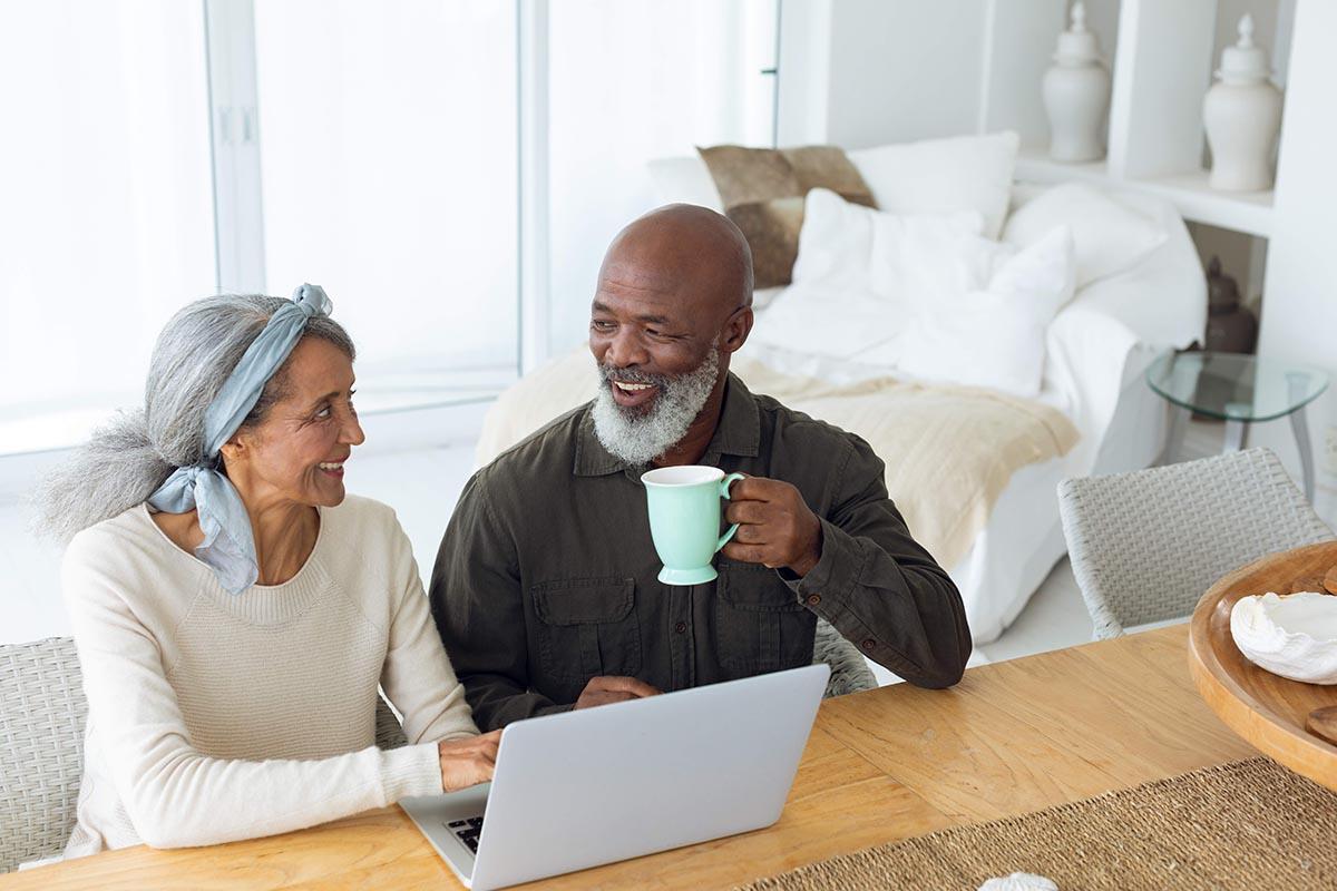 A man and woman at a computer