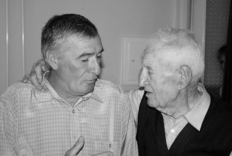 Two men have a conversation