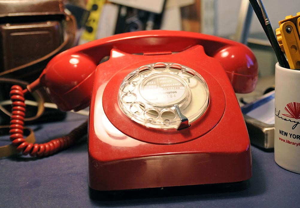 A red rotary phone