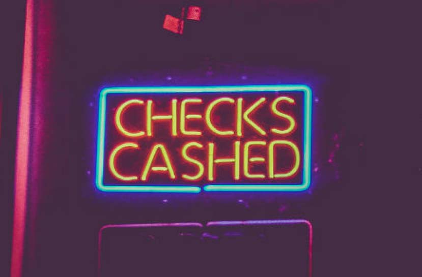 A neon sign that reads Checks Cashed