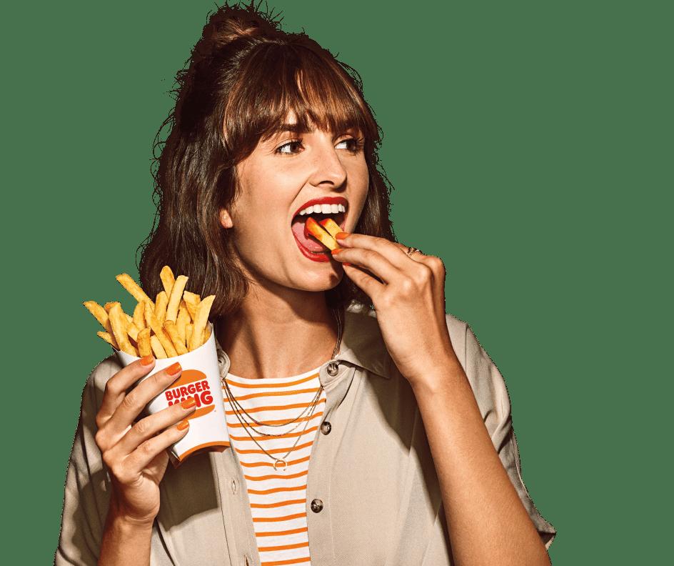 Woman eating fries.