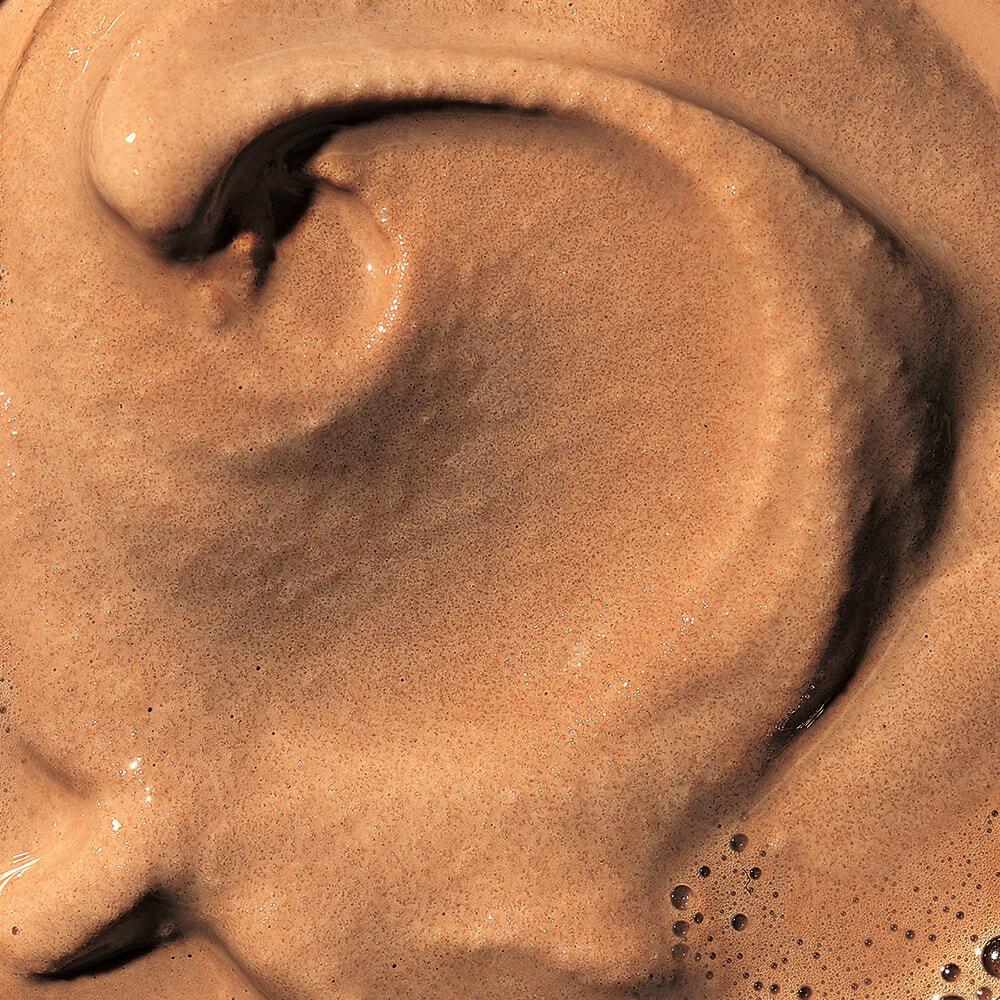 Chocolate shake made with chocolate syrup.