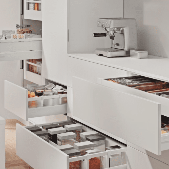 Custom drawer layout solutions for the kitchen and the bathroom.