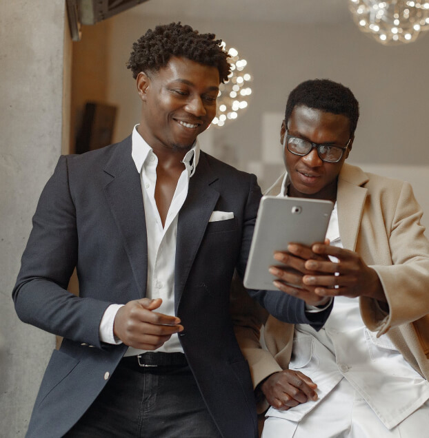 Two young businessmen looking at a tablet