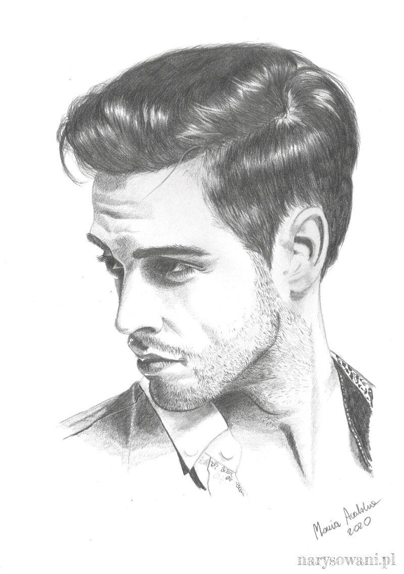 Portret przystojnego, młodego mężczyzny z delikatnym zarostem.