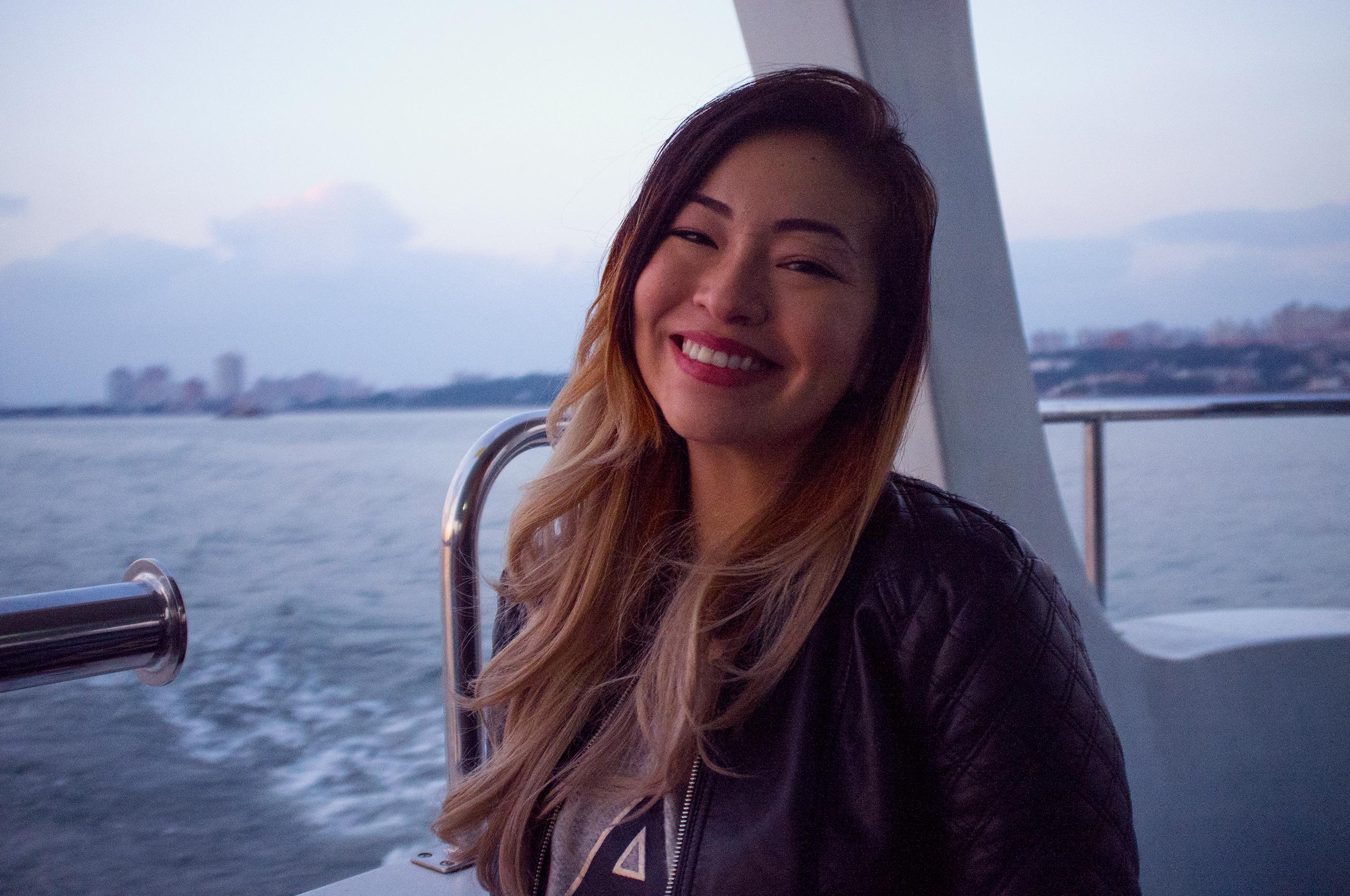 Devon smiling on a boat