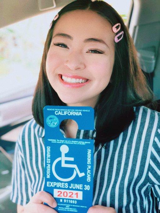 Devon holding a disability placard