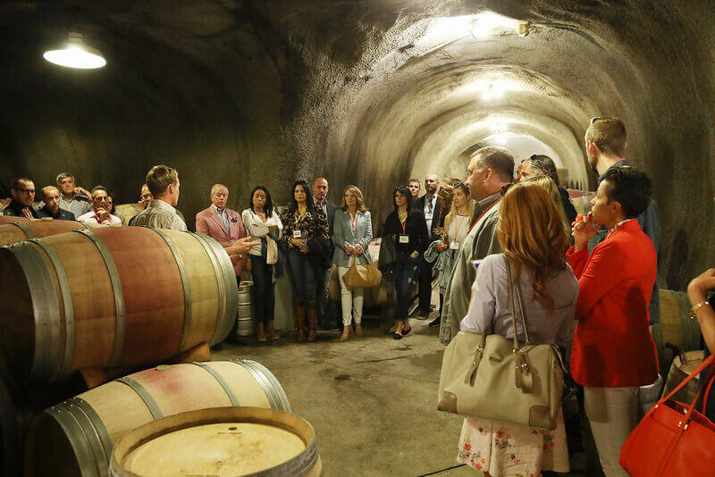 The Elliot Group in a wine cave.