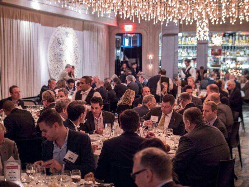People having dinner at an event in New York City.
