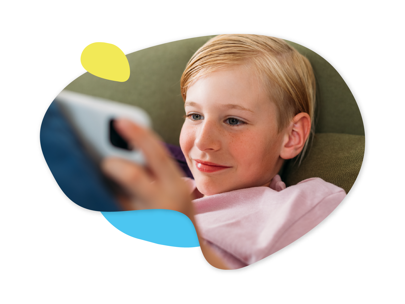 A closeup of a young boy looking at a tablet