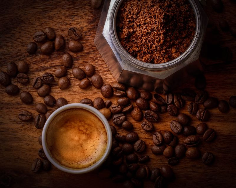 Espresso grounds and beans, and a cup of coffee [Unioncrate]