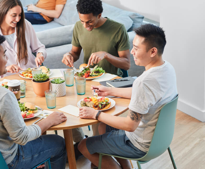 Group gathered around a table eating