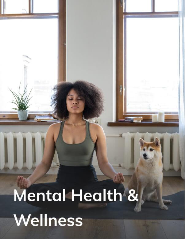 Women meditating with dog