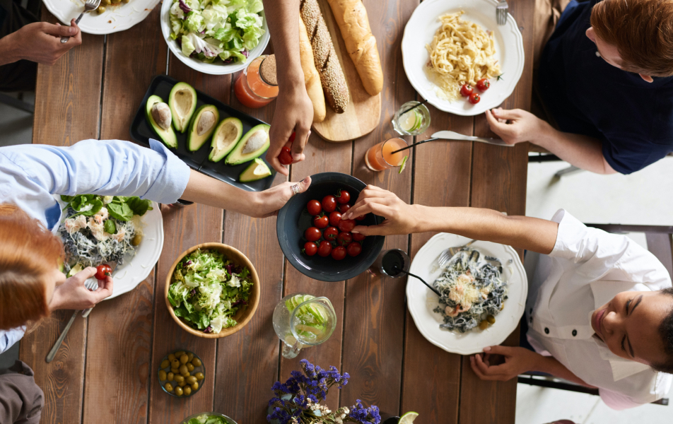 Group of people's hands reaching for food