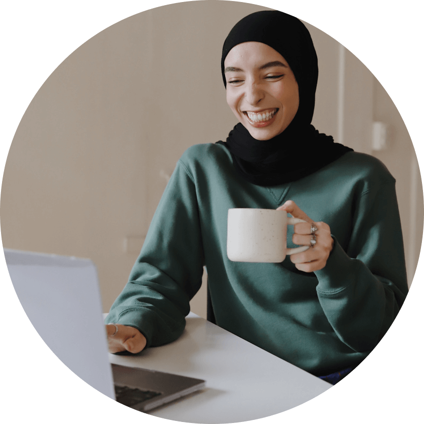 Women smiling during a Thriver virtual coffee tasting activity.