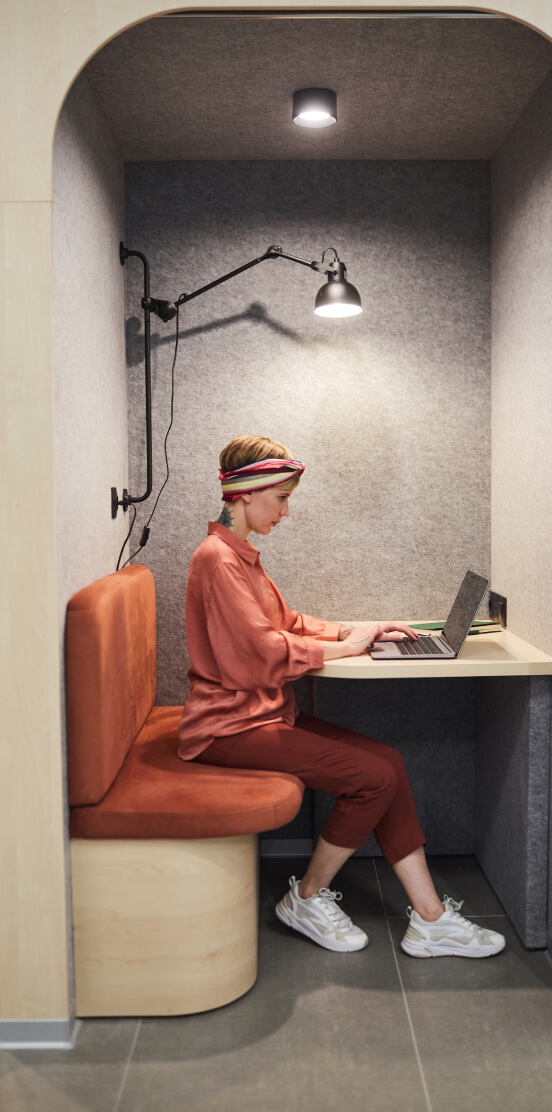 Adult working in an individual booth