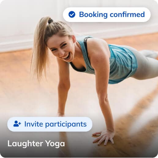 Smiling person standing in a high plank position during a laughter yoga class