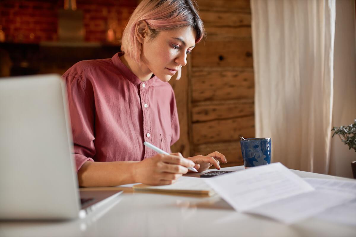 Nonprofit accounting software: woman manually balancing her books