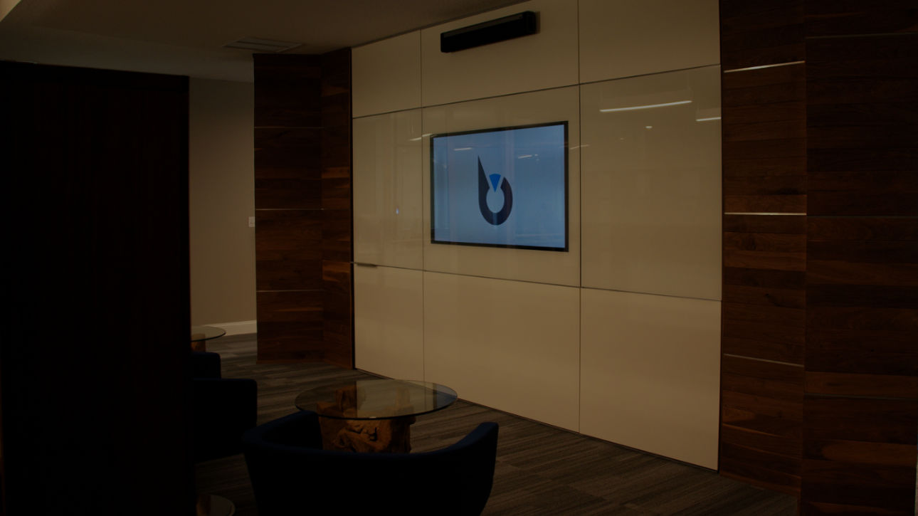 Image of whiteboard with TV screen embedded.