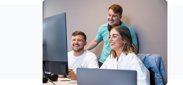 A image of people working around a computer - Wayflyer helping eCommerce grow