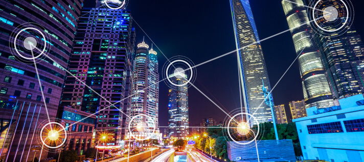 Smart city with fast moving traffic and data points on buildings