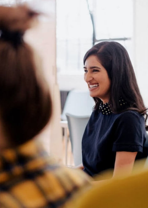 Image of a girl smiling in casual business attire
