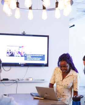 Image of a girl giving a presentation from her laptop