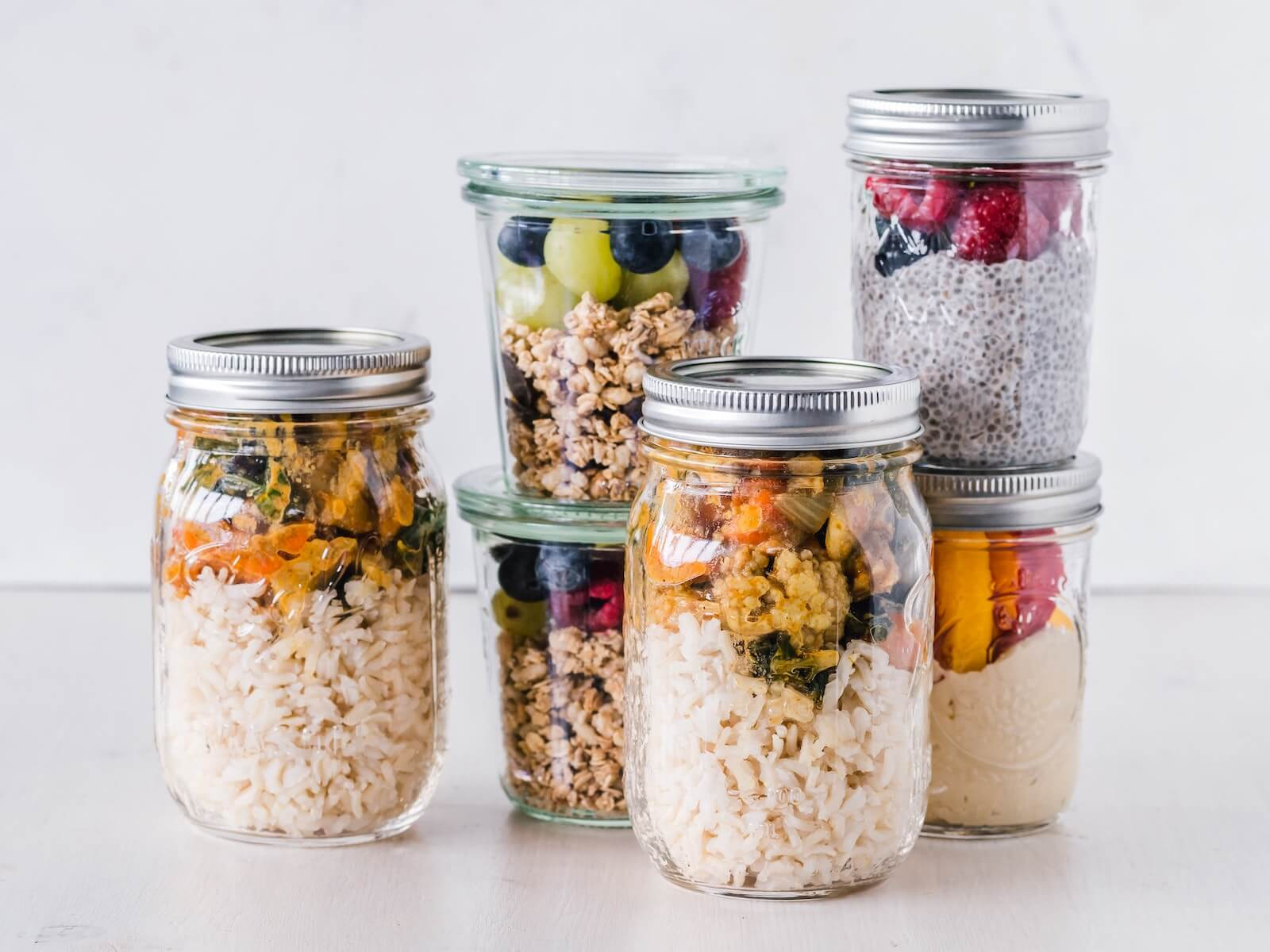 stack of mason jars with a variety of healthy snacks inside staying healthy at work as a nurse