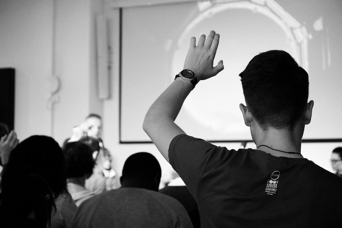 man in classroom raising his hand things they didn't tell you in nursing school