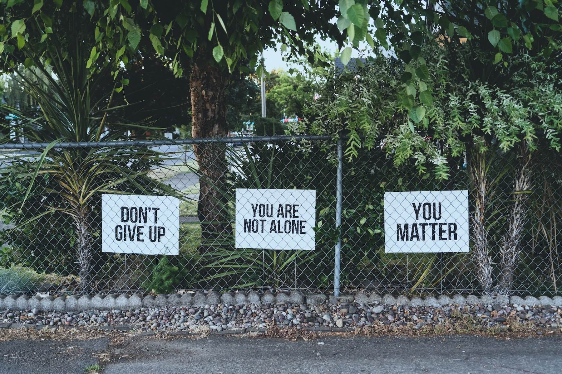 photos of motivational signs on fence mental health awareness month OSU trusted health mental health partnership