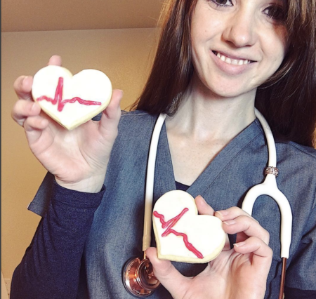 anna rodriguez rn holding up heart cookies burnout warrior